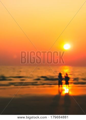 Man And Woman Sweet Lover On The Beach With Sunset