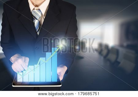 Double Exposure Businessman Hand Touching Virtual Panel Of Growth Bar Chart On Financial Graph Chart