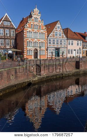 STADE, GERMANY - MARCH 27, 2017: Old houses with reflection in the water in Stade, Germany