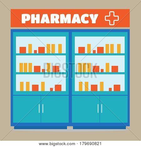 Male pharmacist in a pharmacy opposite the shelves
