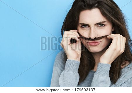 Green eyed woman disguised with own hair portrait