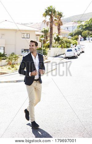 Classy casual Guy walking in road smiling