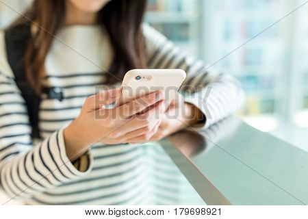 Woman checking something on cellphone