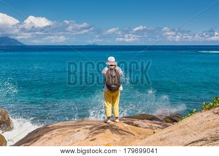Anse Major Mahe Seychelles - December 16 2015: Female tourist on the Anse Major Nature Trail in the hike near the town of Bel Ombre Seychelles.