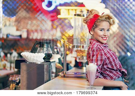 Pin-up girl in retro cafe
