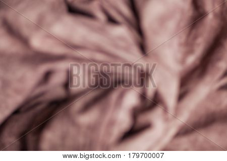 Coffee color checked fabric as a background. Bokeh, fashion, clothes, textured background, sewing industry, cozy and home concept.