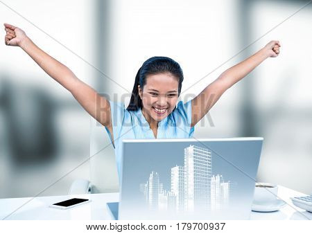 Digital composite of Woman at desk with hands in air behind white graphic of buildings and against blurry grey window