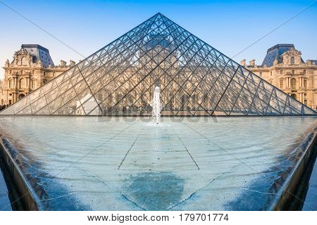 PARIS FRANCE- March 21: The large glass pyramid and the main courtyard of the Louvre Museum on march 21 2015. The Louvre Museum is one of the largest museums of the world