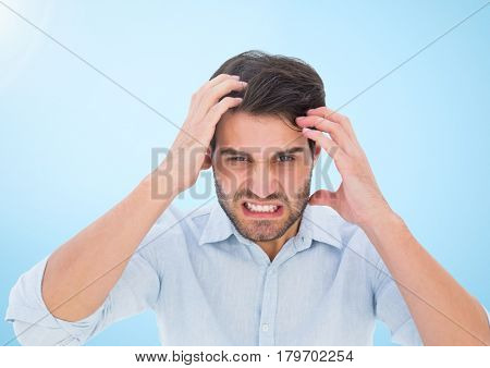 Digital composite of Stressed man against blue background
