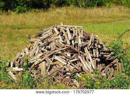 Rural Stack Firewood. Rural Stack Firewood lanscape view.