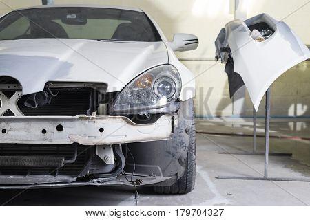 Auto body repair series: Closeup of white sport car waiting for repaint