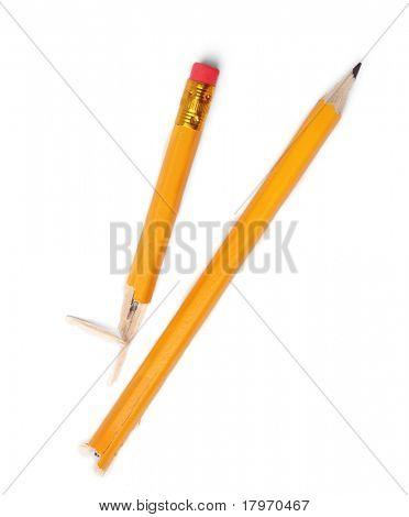 broken pencil on white background