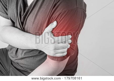 shoulder injury in humans .shoulder pain,joint pains people medical, mono tone highlight at shoulder