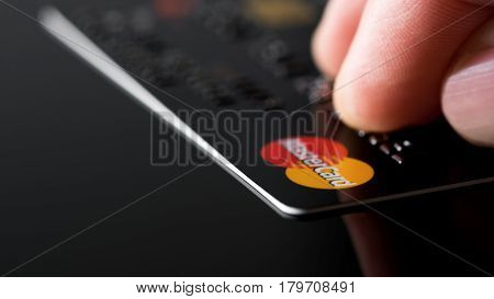 Estonia, Tallinn, March 23, 2017. Plastic card Mastercard. Selective focus