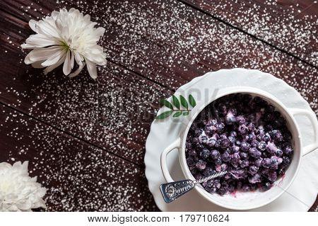 Bilberry with vanilla ice cream against a dark background