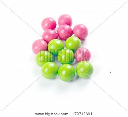 A Pile Of Colorful Gumballs On A White Background.