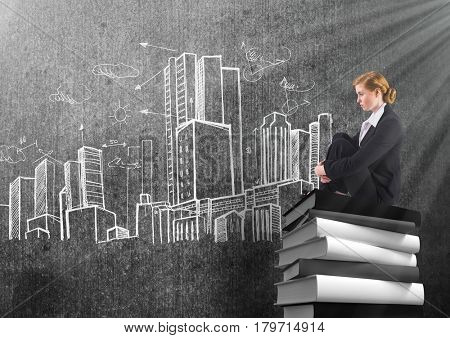 Digital composite of Businesswoman sitting on 3D Books stacked by city buildings drawings