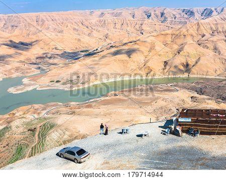 Tourists At Viewpoint Over Al Mujib Dam In Jordan