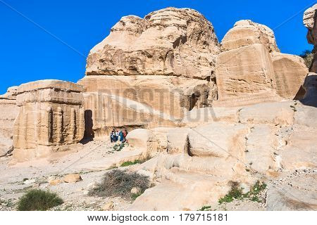 Tourists Near Djinn Blocks In Bab As-siq Of Petra