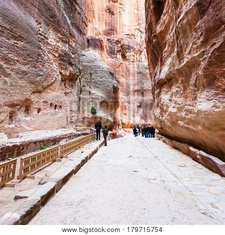 People Near Niches In Al Siq Gorge To Petra Town