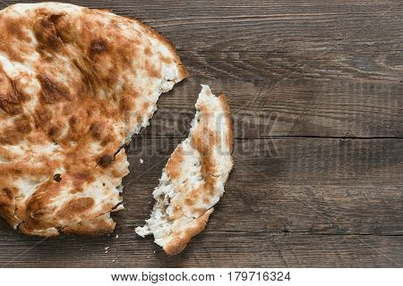 Traditional asian bread. Flatbread on wooden background