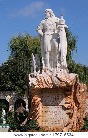 RAVADINOVO BULGARIA - SEPTEMBER 06 2017: Statue of George Tumpalov owner of the castle Love in the Wind next to the entrance to the castle