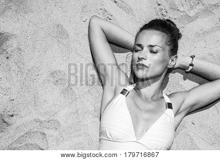 Relaxed Woman In Swimsuit Laying On The Sand