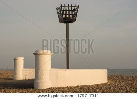Old warning beacon on the beach at Bognor Regis in West Sussex England