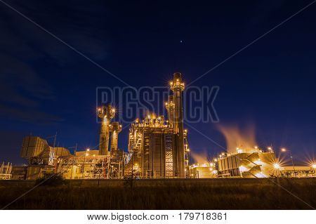Gas turbine electrical power plant with blue hour at dusk