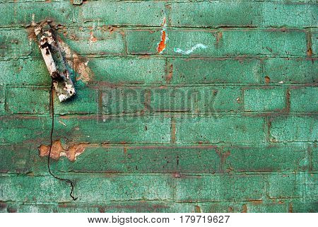 Old green brick wall with old handle