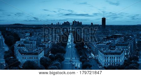 Paris rooftop view of the city skyline with la Defense business district in France.