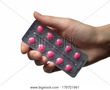 Woman Hand holding medical drugs - full silver leaflet of red pills in common tablets shape, isolated on white