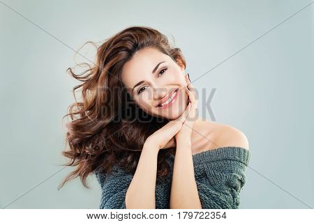 Cute Woman Fashion Model. Happy Beautiful Girl with Curly Hair Healthy Skin and Natural Makeup. Aesthetic Medicine and Cosmetology Concept
