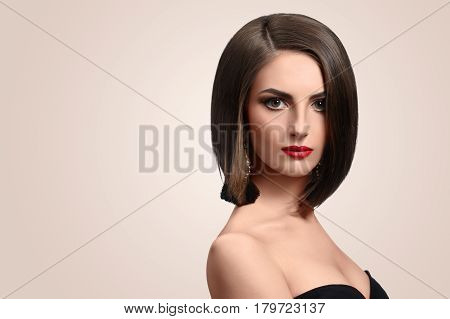 Red lips classic. Beautiful young woman with evening makeup posing gracefully in studio copyspace red lips smoky eyes beauty cosmetics fashion salon confidence femininity concept