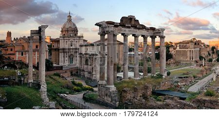Rome Forum with ruins of ancient architecture at sunset with colorful cloud. Italy.
