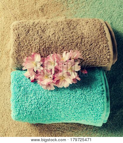 Spa Concept. Top view of beautiful Spa Products. Beautiful flowers towels spa salt sand.