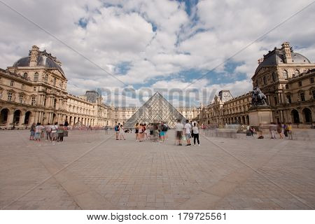 Paris, France - Augest 2016. Louvre Museum. Famous historical art landmark in Europe. Romantic, tourist, architecture, beautiful symbol. Day. Toned