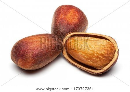 Closeup of pine nuts, isolated on the white background, clipping path included.