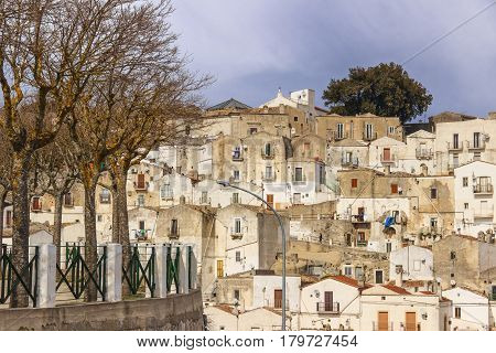 Monte Sant'Angelo is a town on the slopes of Gargano. View of the district Junno characterized by the presence of many terraced houses surmounted by a large and unique window with gabled roof (Italy).