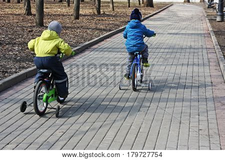 Children's sports entertainment. Images of children who ride children's bicycles.