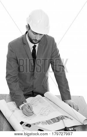 Architect on duty. Monochrome studio shot of a professional constructionist wearing protective hardhat working on a building project isolated on white professionalism experience success development