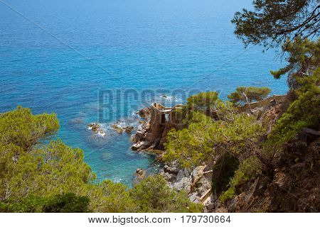 Picturesque sea landscape of the Lloret de Mar in summer. Beautiful aerial view of the beach of Lloret de Mar in Costa Brava Catalonia Spain. Colorful Horizontal Wallpaper