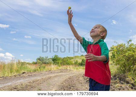 upper a hand throw an apple Boy