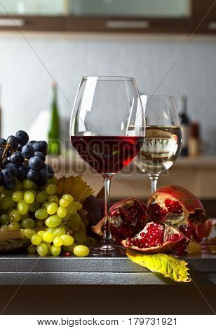 Ripe Juicy Grapes And Glasses Of Wine