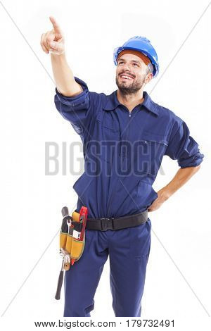 Smiling young worker pointing at copy space, isolated on white background