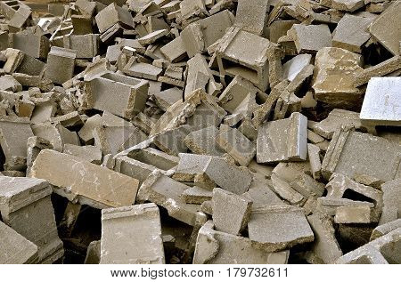 Broken concrete building  blocks are in a demolition state after demolishing a building