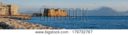 Castel dell Ovo at sunset in the bay of Naples italy