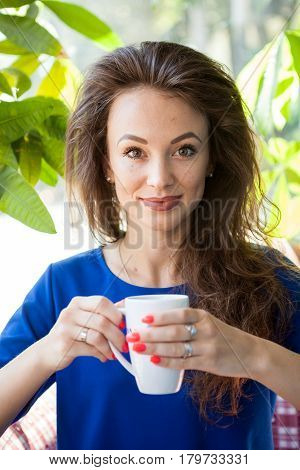 Gorgeous woman drinking a cup of coffee. Coffee drinker.