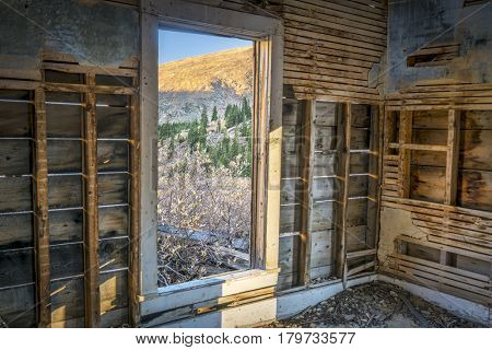 mountain view through door of abandoned house, Rocky Mountains near Mosquito Pass, Colorado