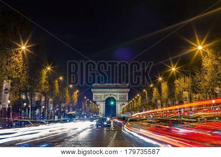 View Of Arc De Triomphe And The Avenue Champs-elysées By Night. Famous Touristic Places And Romantic